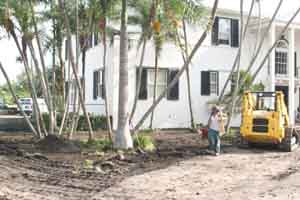 Landscape company crew cleaning up a landscape project in Hollywood Florida